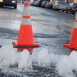 street water leak with orange cones